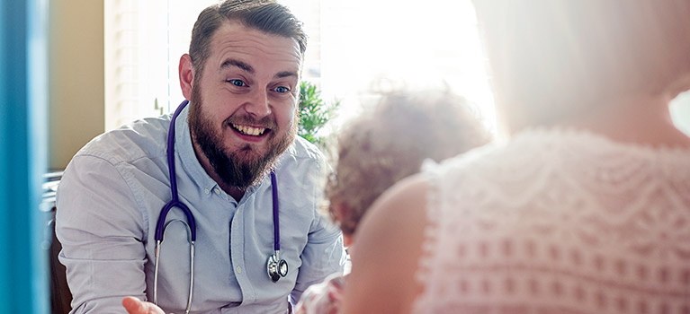 Doctor speaking with young child